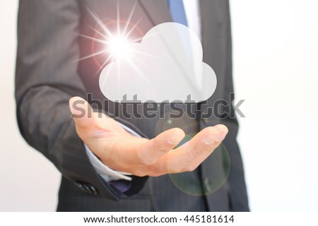 Cloud and Businessman - stock photo