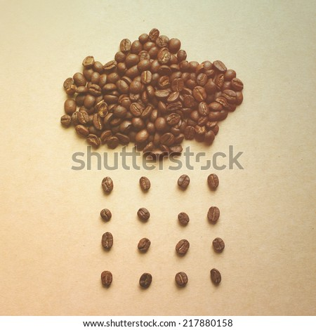 Cloud and rain from coffee beans, nostalgic still life, retro instagram filter effect - stock photo