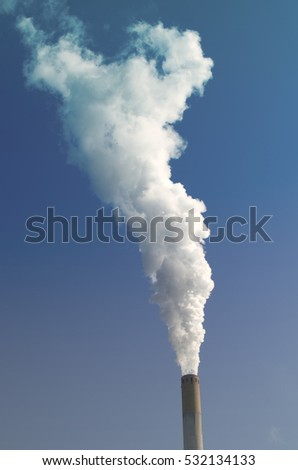 Cloud by industrial chimney