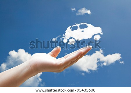 Cloud car flying from hand  to sky - stock photo