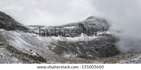 Cloud coming on the top of the mountain in winter. Glacier National Park, Montana