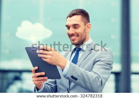 cloud computing, business, internet technology and people concept - smiling businessmanwith tablet pc computer on city street - stock photo