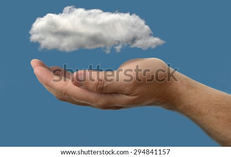Cloud computing concept, close up of cloud over hand