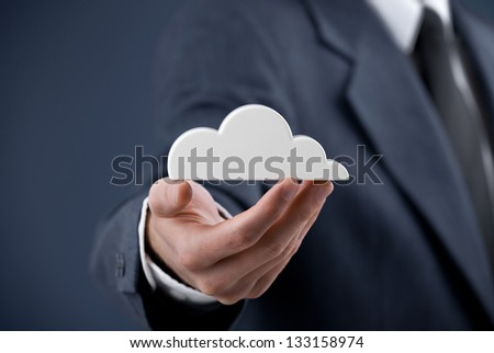 Cloud computing concept. Man hold cloud. - stock photo