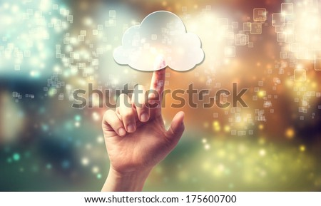 Cloud computing symbol being pressed by a persons hand - stock photo