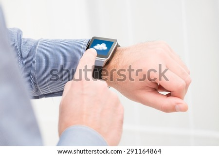 Cloud computing technology with smart watch. Smartwatch concept. - stock photo