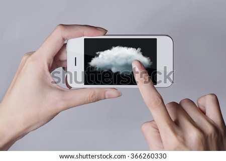 Cloud computing technology with smartphone and hands on grey background. Cloud computing is a general term for the delivery of hosted services over the Internet.