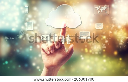 Cloud computing theme with person pushing cloud button - stock photo