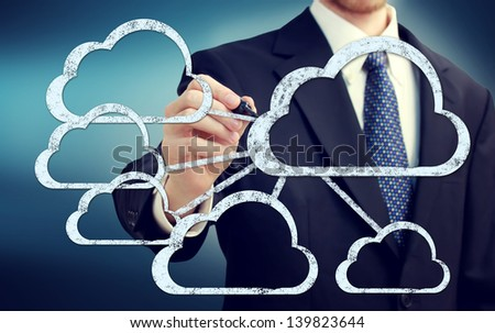 Cloud flow chart with businessman on blue background - stock photo