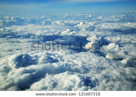 Cloud formations seen from the plane - stock photo
