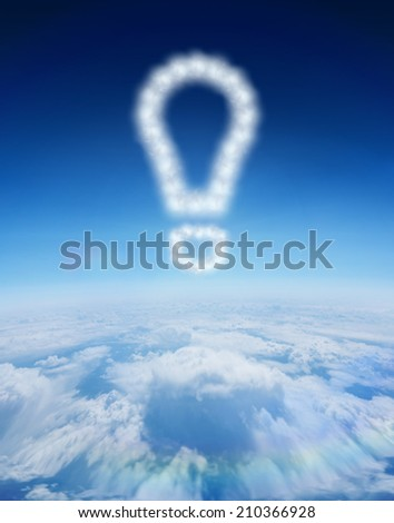 Cloud in shape of exclamation mark against blue sky over clouds at high altitude