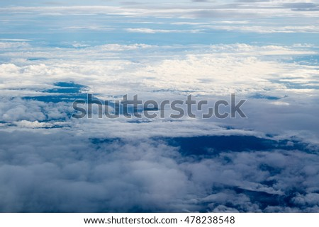 Cloud in the sky by plane window view