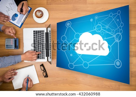 Cloud Networking Communication Connection Business team hands at work with financial reports and a laptop - stock photo