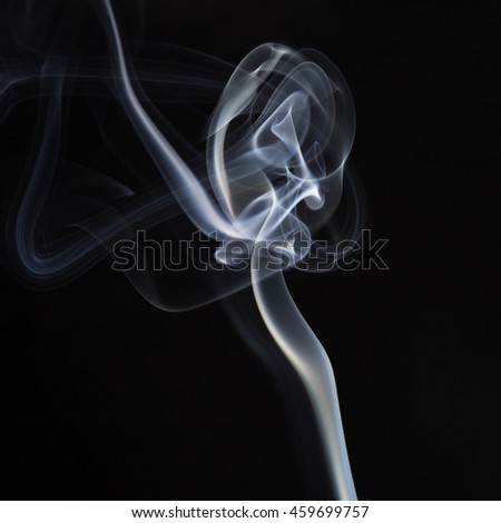 Cloud of smoke on black background
