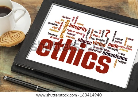 cloud of words or tags related to ethics and moral dilemma on a  digital tablet - stock photo