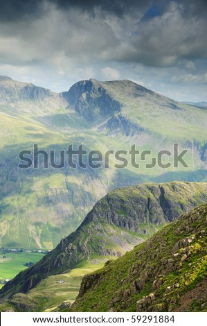 Cloud shadows on Scafell, Yewbarrow and Red Pike in the English Lake District - stock photo
