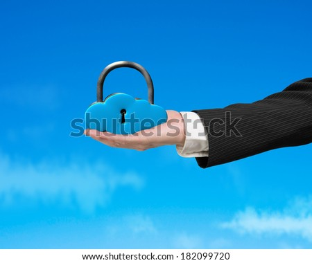 Cloud shape lock on hand with blue sky background - stock photo