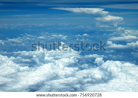 cloud & sky seen above in airplane