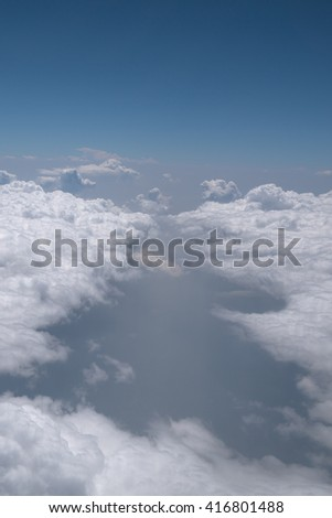 Cloud space background with blue sky, view from window of airplane - stock photo