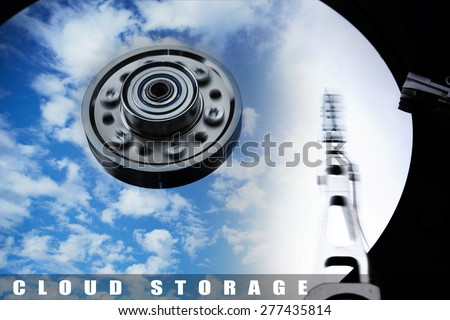 Cloud storage or cloud drive concept image. Hard disk (Hard drive) with clouds and sky reflecting on disk.  - stock photo