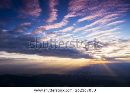 Cloud streaks Phu Hin Rong Kla National Park. - stock photo