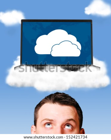 cloud technologies, man is looking at modern laptop in skies - stock photo