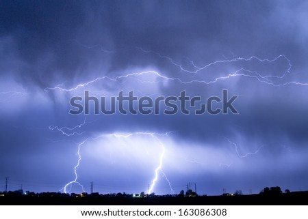 Cloud-to-ground lightning bolts are a common phenomenon about 100 strike Earth'??s surface every single second. Each bolt can contain up to one billion volts of electricity. - stock photo
