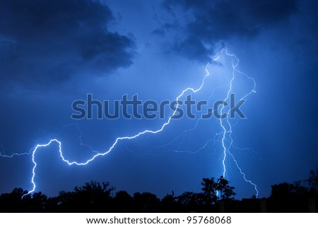 Cloud to ground lightning strikes over Albuquerque, New Mexico. July, 2011. - stock photo