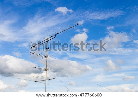 Cloud with blue sky and television signal pole