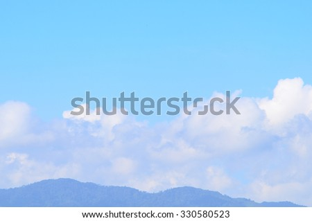 cloud with moutain this image focus main on sky with cloud and have selective empty space for text.