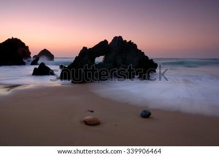 cloudless , Beach fan, Cascais, Portugal - stock photo
