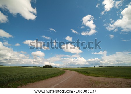 Clouds above rural road.