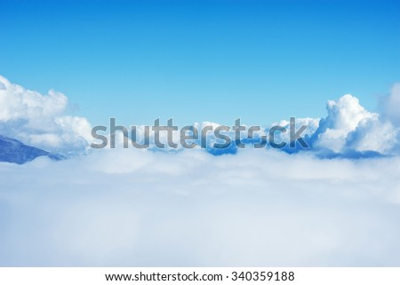 Clouds above the mountains at day time.  - stock photo