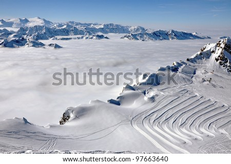 Clouds and fog above, beautiful sunny winter landscape in the Austrian Alps