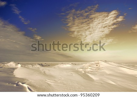 Clouds and Glow over Lake Erie in Winter - stock photo