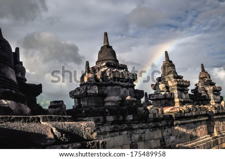 Clouds and Rainbow Buddist temple Borobudur complex in Yogjakarta in Java, indonesia - stock photo