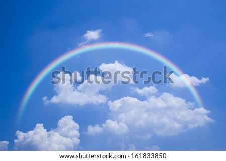 Clouds and rainbow in the sky - stock photo