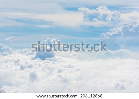 Clouds and sky, aerial view from airplane window. - stock photo