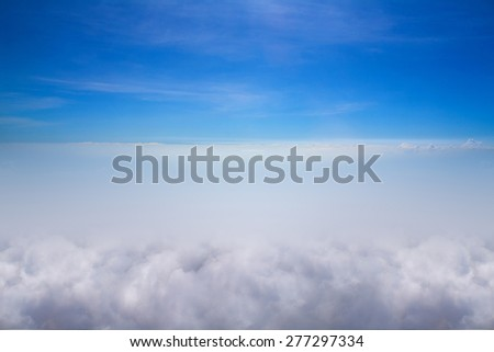 Clouds and sky blue, Viewed from an airplane window - stock photo