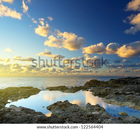 Clouds and sky during bright sunset. Natural seascape - stock photo