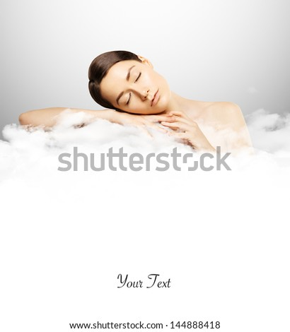 clouds and sleeping girl - stock photo