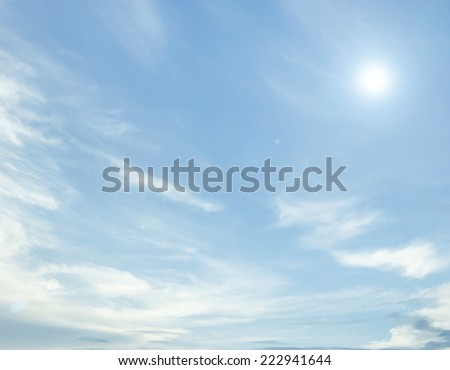 clouds and sun in the blue sky