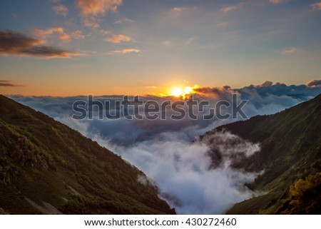 Clouds and sun in the mountains. Beautiful  landscape at sunset.   Russia, Caucasus nature reserve - stock photo