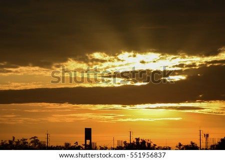 Clouds and Sunset with sun rays.