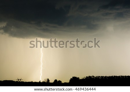 clouds and thunder lightnings and storm on the dark cloudy sky