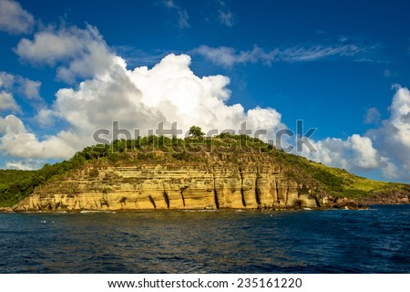 Clouds blowing over the pillars of Hercules in Antigua - stock photo
