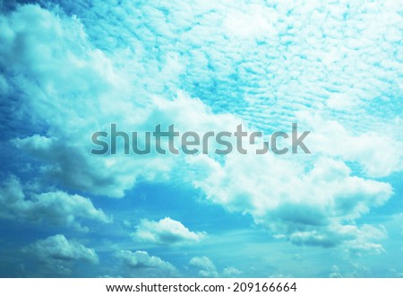 Clouds, both large and small, a brilliant white , some of gray , floating in the blue sky.                               - stock photo