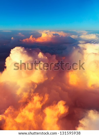 Clouds. bright morning dawn in the sky. sunset with a height of 10 000 km. Top view. - stock photo