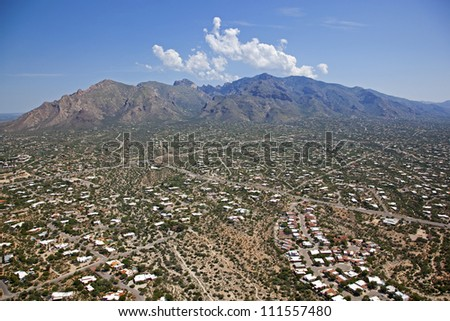 Clouds building over the Santa Catalina Mountains in Tucson, Arizona - stock photo