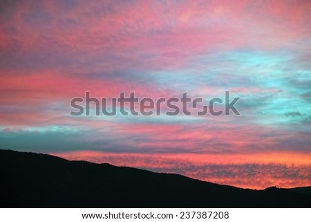 clouds colored by sunlight at dawn  - stock photo
